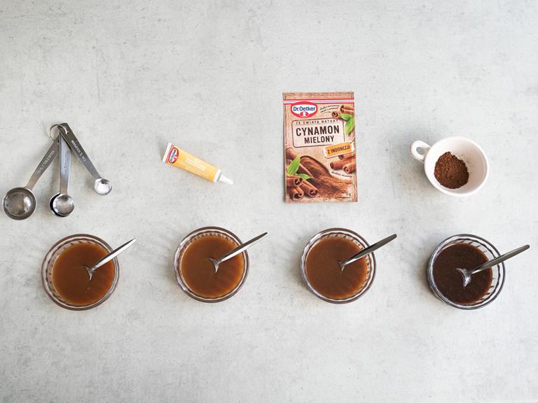 Sos karmelowy w 4 miseczkach. Do jednej została dodana sól. do drugiej pasta z wanilii, do 3 cynamon i do 4 kakao.