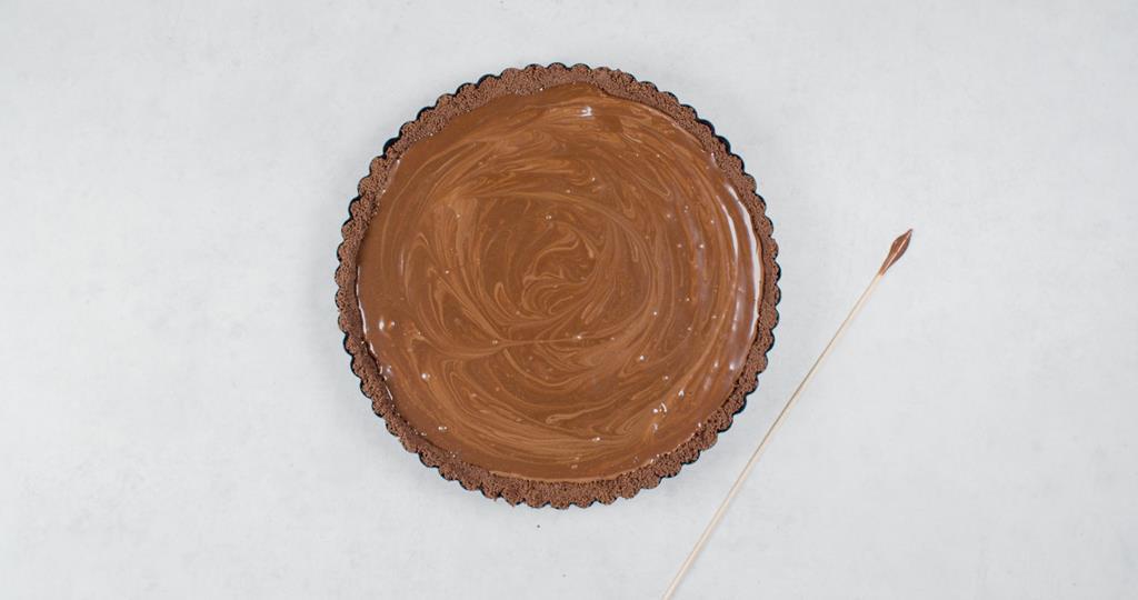 Polewa czekoladowa położona na kremie czekoladowym